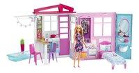 Barbie poppenhuis met zwembad en pop-commercieel beeld