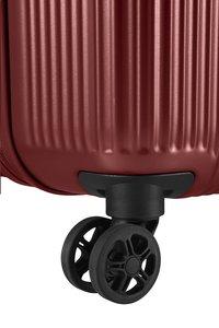 Samsonite harde reistrolley Rectrix Spinner Matte Red 55 cm-Onderkant
